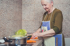 grandmother-making-salad-her-kitchen-54814498