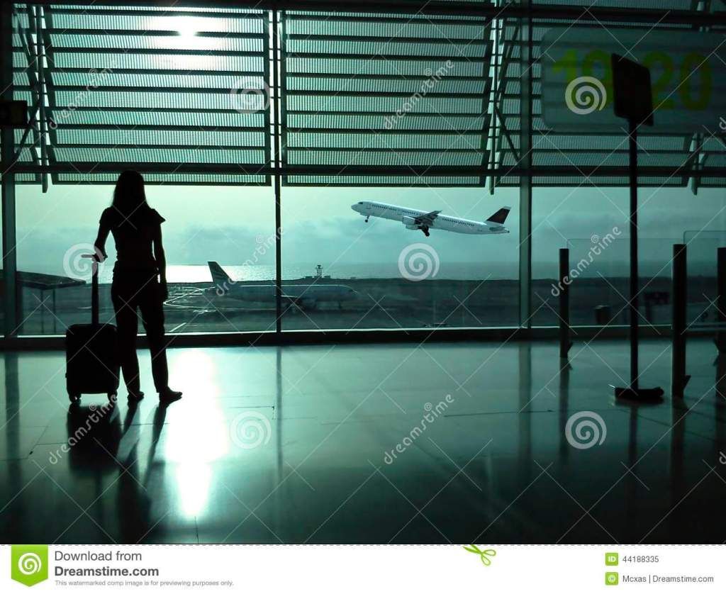 woman-suitcase-airport-backlight-view-silhouette-plane-takinf-off-bottom-44188335