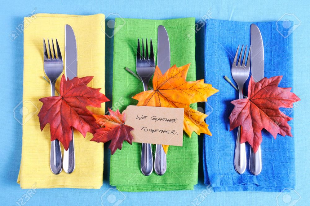 33560554-happy-thanksgiving-table-place-setting-with-we-gather-together-place-card-and-autumn-fall-leaf-decor-stock-photo