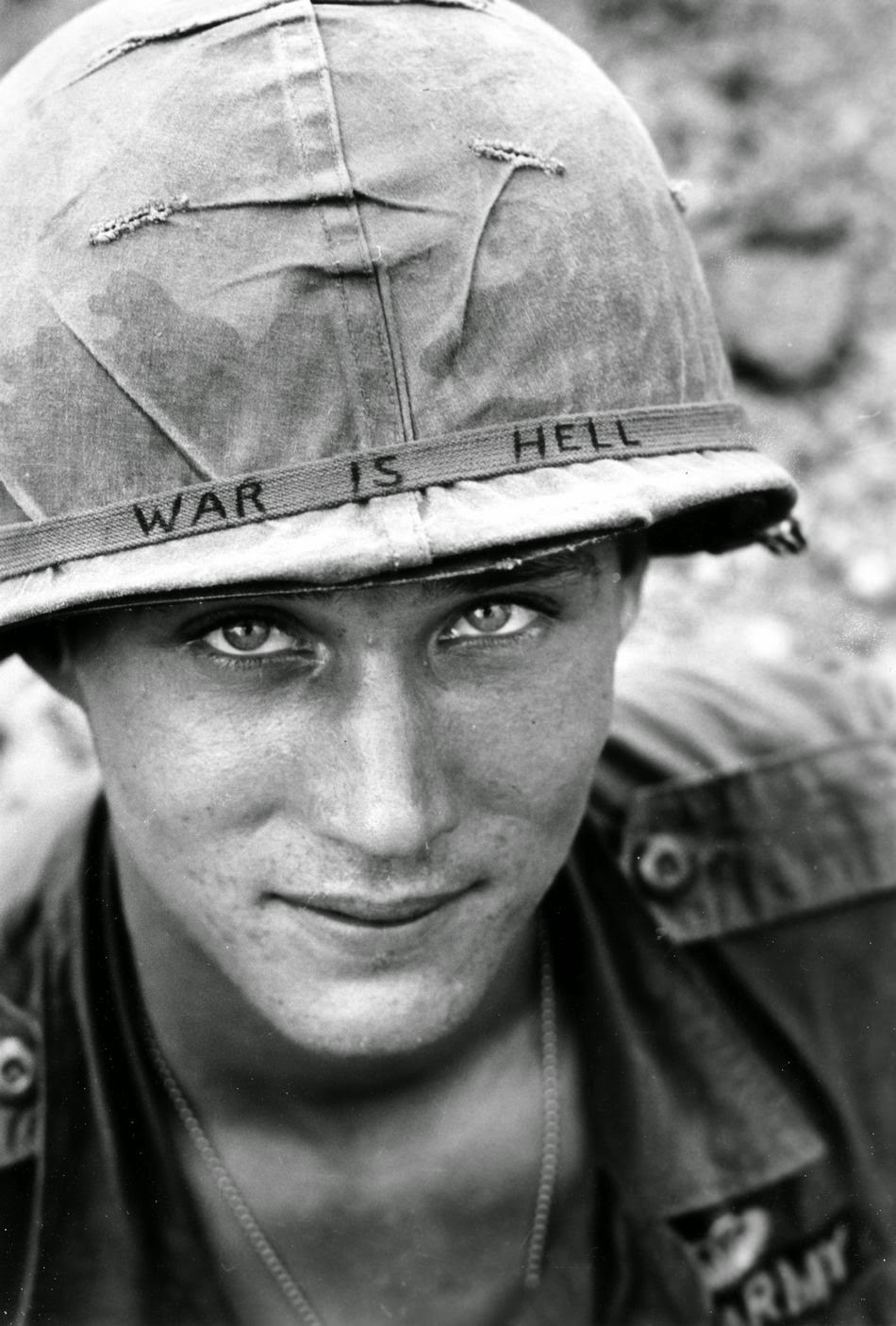 An American soldier wears a hand lettered War Is Hell slogan on his helmet, Vietnam, 1965