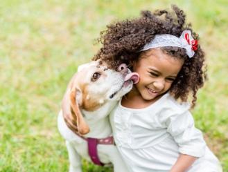 dog-licking-girl-face_152097917_0