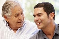 hispanic-father-adult-son-55892944