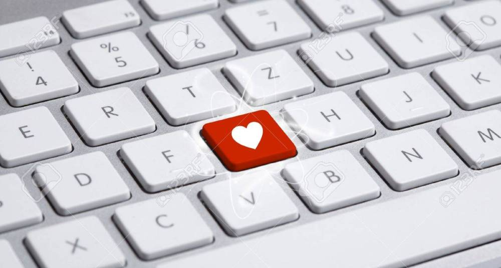 12685273-white-keyboard-with-heart-sign