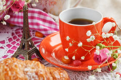 cup-coffee-croissant-small-eiffel-tower-decorated-napkins-roses-candies-white-wooden-table-85342890