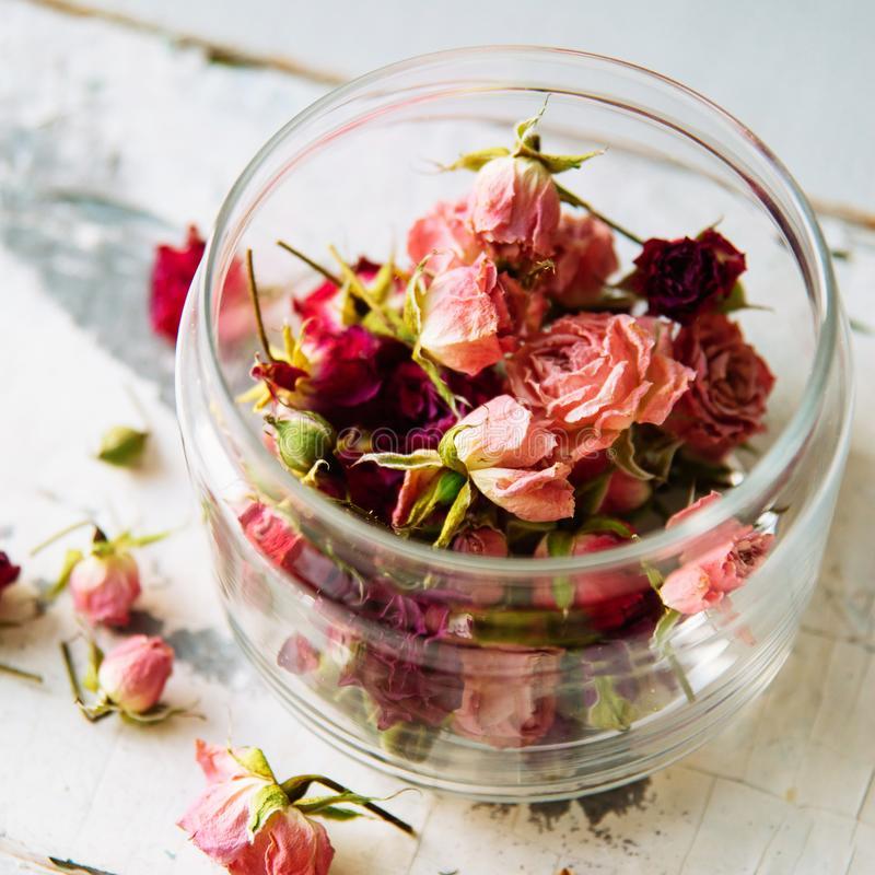 dried-rose-petals-glass-jar-buds-tea-strainer-selective-focus-108295677