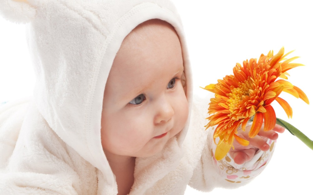 baby and flowers