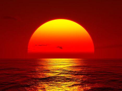 sunset-big-orange-sun-setting-over-ocean