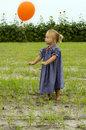 little-girl-letting-go-balloon-9856799