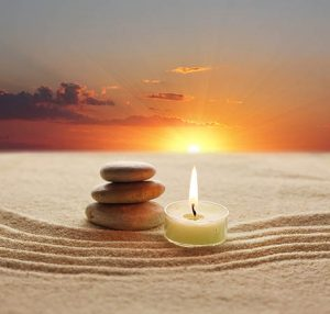 stones-candle-sand-ca109354969-web-300x286