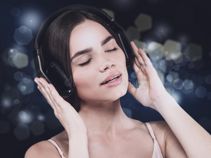 beauty-young-girl-hearing-music-headset-female-portrait-64896630