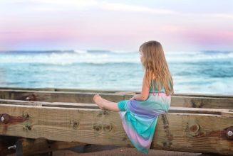 bigstock-little-girl-sitting-on-a-bench-110317817-e1476461330117